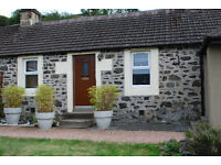1 bedroom cottage with separate front and back door entrances.