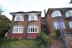 A three bed flat with two bathrooms and open plan kitchen with large private rear garden