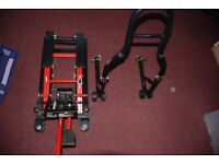 MOTOR BIKE TROLLY LIFT AND A REAR WHEEL PADDOCK STAND. ALMOST NEW CONDITION.