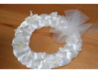 WEDDING DECORATION. IVORY SATIN WREATH, DECORATED WITH BUTTERFLIES AND ORCHIDS. (17 AVAILABLE)