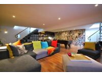 STUNNING 1900 SQ FT SPLIT LEVEL SCHOOL WAREHOUSE CONVERSION WITH PRIVATE PATIO & CINEMA ROOM PARKING