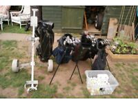 assortment of golf clubs and trolley