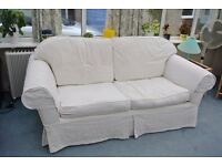 Cream Sofa Bed and matching chair. Has covers easily removed for washing.