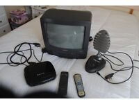 Furguson 14 inch colour TV, built in VCR recorded/player, DVD player and booster aerial.