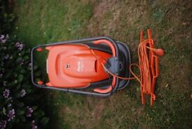 Flymo Turbo Compact 330 mower in good condition with lengthy extension