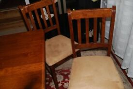 Solid wood table and 4 chairs - excellent condition