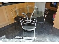 Round glass dining table and 4 chairs