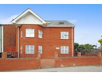 A modern two bed furnished flat with two bathrooms with private patio close to Woodside Park Station