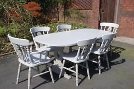 A High Quality unique hand painted extendable Dining Table and 6 Chairs. in Two Tone Grey. 2 Carvers