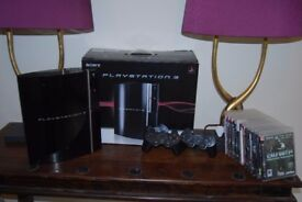 Playstation 3, 2 x dual shock controllers and 12 games