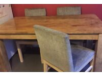 Solid oak very heavy dining table & 4 chairs, used