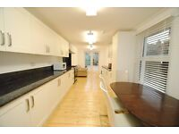 A refurbished four bed house with two receptions and modern furnishings close to local transport
