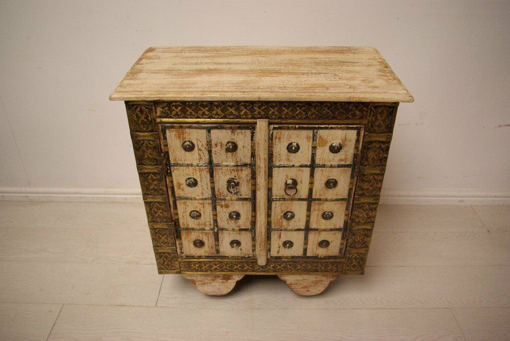 Beautiful antique hand stencilled brass and solid wood wheeled bedside table unitin West London, LondonGumtree - This Beautiful antique bedside units consist of hand stencilled brass emrboidery and the finest quality solid wood. The unit contains 4 wheels attatched at the legs or easy transportation and convenience. The unit is made in India and has been kept...