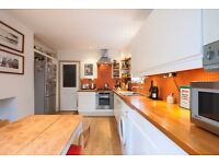 A BEAUTIFULLY PRESENTED THREE BEDROOM SPLIT LEVEL CONVERSION WITH EAT IN KITCHEN ON ELSPETH ROAD