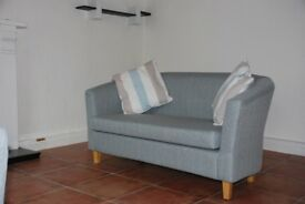 Pair of two seater sofas