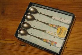 Set of stainless steel spoons with porcelain handles
