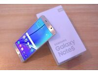 Samsung galaxy note 5 GOLD Unlocked + box + charger un mint condition