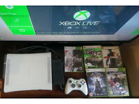 Xbox 360 + 5 games + controller. In Excellent working condition!
