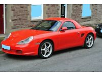 manual red Porsche Boxster 2.7 with hard top