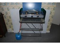 Camping cooker with grill, gas and kitchen stand