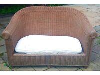 Garden wicker sofa with cushion