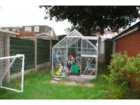 A 6' x 8' Aluminium & Glass Greenhouse for sale.