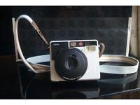 Leica Sofort Instant Camera including original case, 2 straps, 3 films and more!