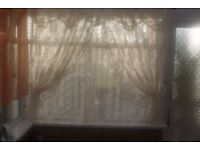 TWO SEPARATE CREAM LACE CURTAINS STRAIGHT AND FRILLED EDGE DRAPE WITH TIEBACKS, CAN POST