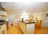 A stunning two bedroom conversion apartment with private garden, located on Mallinson Road
