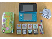 Nintendo 3DS with 8 games, moshi monsters case, adapter and styluses