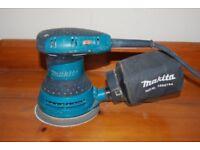 Makita random orbital sander 125mm with dustbag