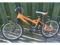 11'' frame bicycle, for 6 to 8 year-old. Orange and black, hardly ever used, looks new!
