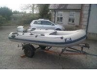 RIB - with Honda outboard and road/launching trailer