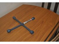 Four way wheel nut wrench