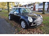 Beautiful Black Mini Cooper with white roof. Full Service History, leather seats and CD changer