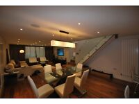 A modern three bedroom detached house arranged over two floors, boasting an open plan kitchen/dinner