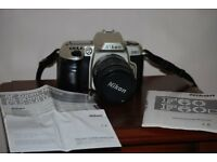 Nikon f60 body lens + 2 booklets+batteries