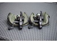 Pair of Daiwa Regal – X 4050 BRT Bait runner reels and padded bags