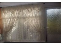 TWO SEPARATE PRETTY CREAM LACE CURTAINS, STRAIGHT AND FRILLED DRAPED WITH TIEBACKS, CAN POST