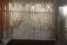 TWO PRETTY CREAM LACE CURTAINS, STRAIGHT, DRAPED FRILLED EDGE WITH TIEBACKS, CAN POST