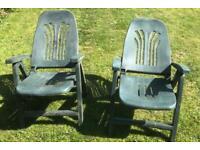 Reclining green plastic garden chairs