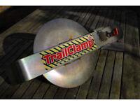 Trailer security wheel clamp.