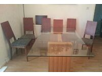 Glass dining table and 6 chairs £100 ono