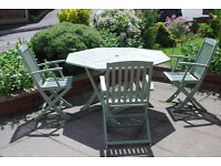 Round folding hardwood table and 3 chairs
