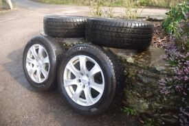 Nearly new alloy wheels fitted with winter tyres