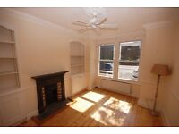 Two bed two bath garden flat with own front door and sunny south facing reception room, avail now