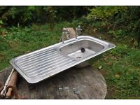 kitchen sink with 2 seperate taps, stainless steel, single bowl.