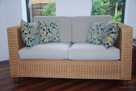Wicker sofas with deep pale grey cushions