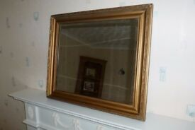 Wall Mirror - bevelled, silvered and in old gold gilt frame