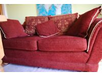 2 1/2 seater deep red settee with a matching arm chair